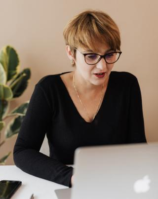 Woman working on a laptop image