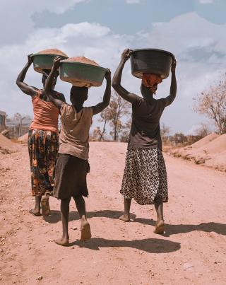 Three women with baskets on their heads